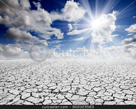 cracked soil landscape stock photo, Colorful dramatic landscape with cracked soil and blue sky by carloscastilla