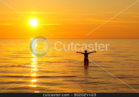Ladoga lake stock photo, Woman bathing in the Ladoga lake at dawn time by Yulia Chupina