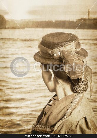 Retro style stock photo, Girl in the clothes in the retro style near the river Neva in St.Petesburg, Russia. Vintage style, grungy effect, sepia tint. by Yulia Chupina
