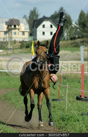 The brave cossack_ stock photo, Alexei Subin in action during the Championship of Saint-Petersburg on military-applied types of equestrian sport - trick riding  by Yulia Chupina