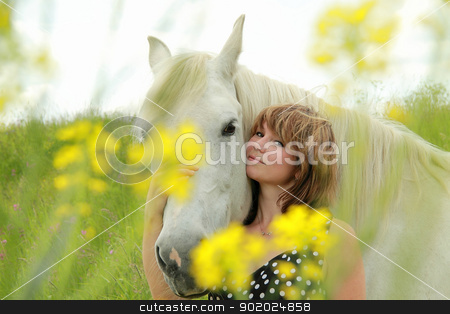 The girl and a white horse stock photo, Portrait of an attractive girl, cuddling her white horse. by Yulia Chupina