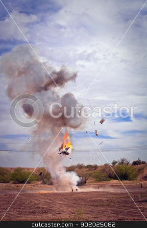 Appliance exploded by movie special effects pyrotechnic team stock photo, Movie special effects exploding appliance in a desert by Scott Griessel