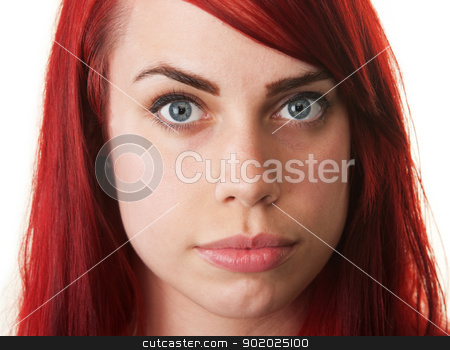 Pretty Woman with Red Hair stock photo, Serious smiling white woman with red hair on isolated background by Scott Griessel