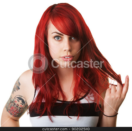Woman Playing With Her Hair stock photo, Serious Caucasian woman with tattoo twirling her hair by Scott Griessel