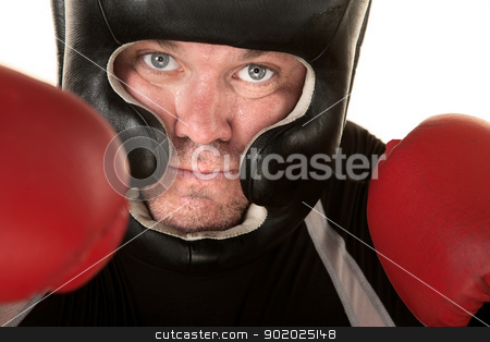 Aggressive Fighter Close Up stock photo, Aggressive Caucasian boxer with headgear and gloves in front by Scott Griessel