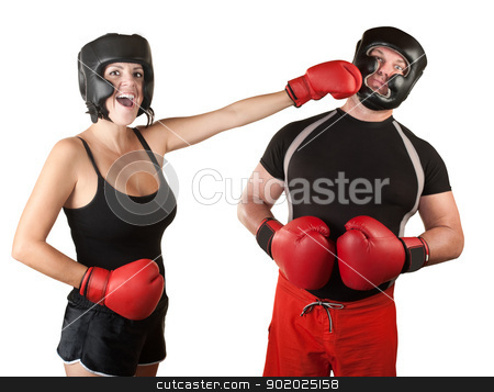 Laughing Lady Boxer Punches Man stock photo, Laughing female boxer over white background punching man by Scott Griessel