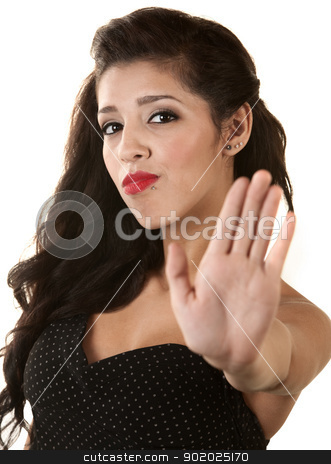 Woman Gesturing to Stop stock photo, Serious beautiful young woman gesturing stop with hand by Scott Griessel
