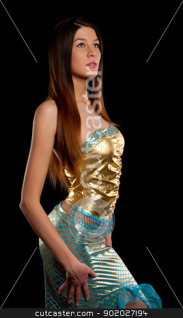 Young mermaid stock photo, Young beautiful woman in mermaid costume. Isolated on black by Aikon
