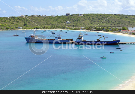Transportation: cargo ships. stock photo, Two ships offloading cargo at caribbean port. by Fernando Barozza