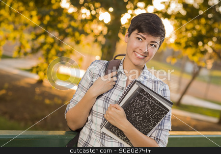 Portrait of Mixed Race Female Student Looking Away  stock photo, Outdoor Portrait of a Pretty Mixed Race Female Student Holding Books Looking Away. by Andy Dean