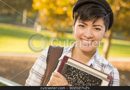 Portrait of a Pretty Mixed Race Female Student Holding Books stock photo, Outdoor Portrait of a Pretty Mixed Race Female Student Holding Books on a Sunny Afternoon. by Andy Dean