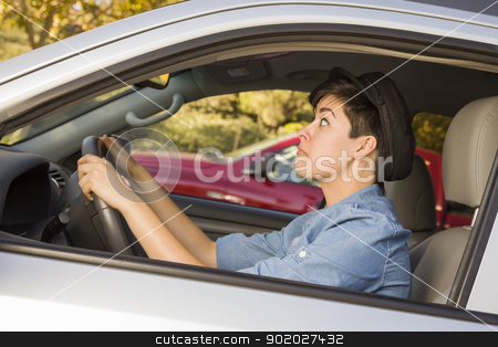 Stressed Mixed Race Woman Driving in Car and Traffic stock photo, Very Stressed Mixed Race Woman Driving in Car and Traffic. by Andy Dean