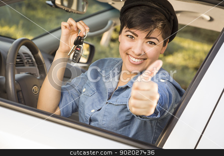 Happy Mixed Race Woman in Car Holding Keys stock photo, Happy Smiling Mixed Race Woman in Car with Thumbs Up Holding Set of Keys. by Andy Dean