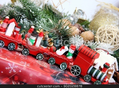 Christmas decorations and toy red train stock photo, Big mix of Christmas decorations with toy red train by Tatiana Mihaliova