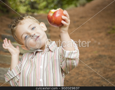 Adorable Child Boy Eating Red Apple Outside stock photo, Adorable Child Boy Eating a Delicious Red Apple Outside. by Andy Dean
