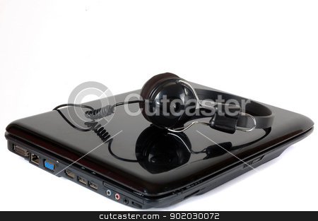 headphones and laptop stock photo, headphones above laptop isolated on white by antonihalim