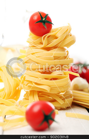 Italian pasta and cherry tomato on wooden surface stock photo, Italian pasta and cherry tomato on wooden surface isolated on a white background by yekostock