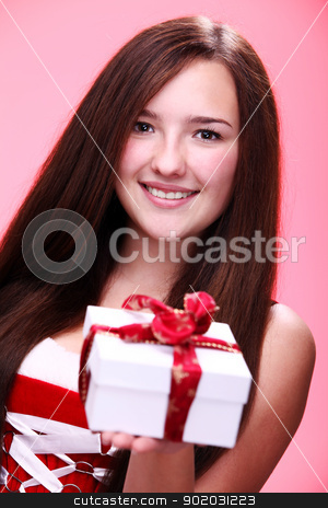 Beautiful christmas girl in red with gift stock photo, Portrait of young and beautiful christmas girl in red with gift by yekostock