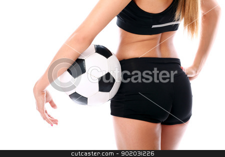 Young and sexy girl`s body with soccer ball stock photo, Young and sexy girl`s body with soccer ball over white background by yekostock