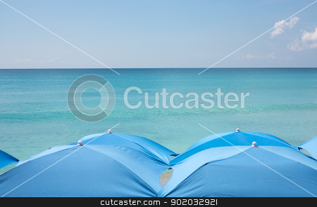 Four beach umbrellas on beach stock photo, Four blue beach umbrellas form pattern on beach on St Martin by Steven Heap