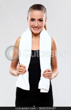 Beautiful brunette with towel stock photo, Beautiful brunette with towel over grey background by yekostock