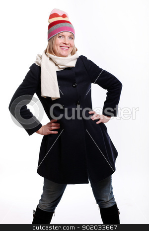 Warm dressed mid age woman stock photo, Warm dressed mid age woman over a white background by yekostock
