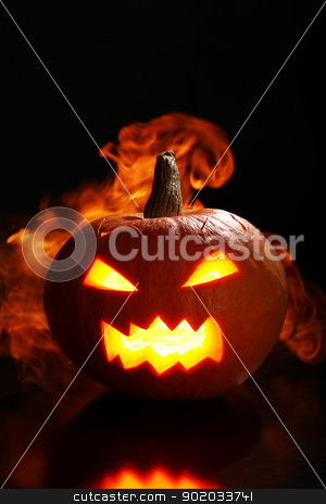 Halloween pumpkin in fire stock photo, halloween pumpkin in fire over a black background by yekostock