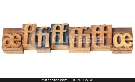 ligature in wood type stock photo, row of ligature symbols in vintage letterpress wood type blocks by Marek Uliasz
