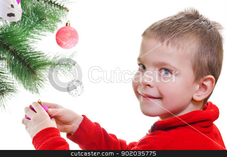 Christmas decoration stock photo, Young boy decorating christmas tree, looking at camera, horizontal shot by Milsi Art