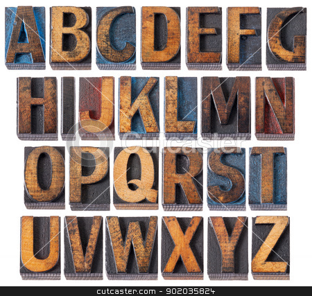 alphabet in antique wood type stock photo, complete English alphabet - collage of 26 isolated vintage wood letterpress printing blocks, scratched and stained by blue, red and black ink by Marek Uliasz