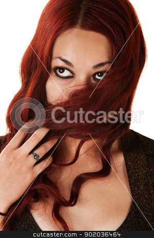 Lady Covering Her Face with Hair stock photo, Young woman covering her mouth with long red hair by Scott Griessel