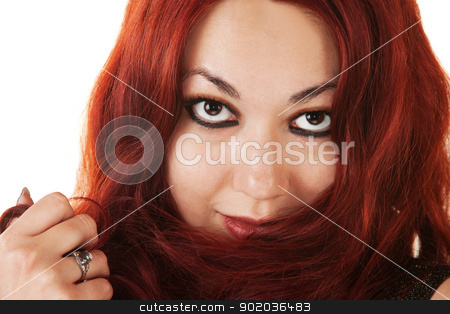 Hispanic Lady Playing with Her Hair stock photo, Seductive young Hispanic woman playing with her hair by Scott Griessel