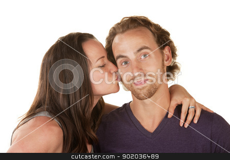Woman Kissing Calm Man stock photo, Calm bearded man kissed by woman over isolated background by Scott Griessel