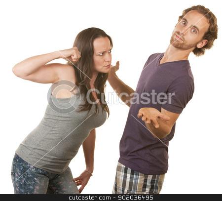 Suspicious Woman Threatens Boyfriend stock photo, Suspicious woman threatening man with her fist by Scott Griessel