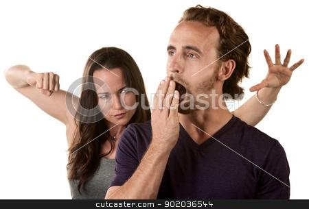 Woman Ready to Punch Yawning Man stock photo, Woman winding up to punch yawning man by Scott Griessel