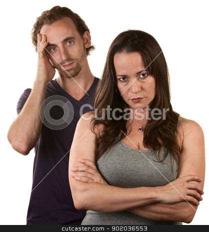 Skeptical Wife With Husband stock photo, Skeptical European woman and man in with hand on head by Scott Griessel