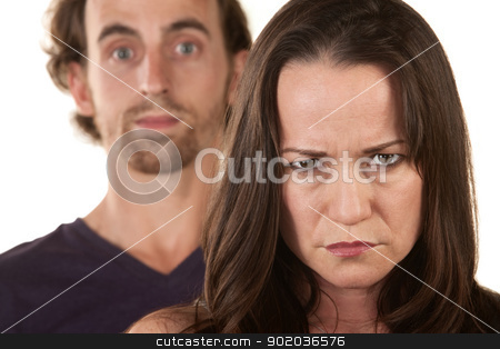 Angry Woman and Innocent Man stock photo, Angry Caucasian woman frowning with man behind her by Scott Griessel