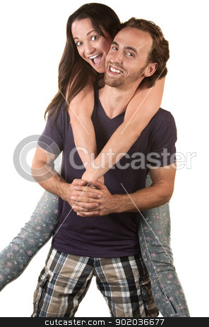 Joyful Woman Jumping on Husband stock photo, Joyful couple with woman riding the back of the man by Scott Griessel