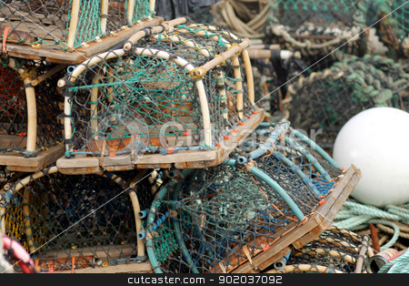 Lobster pots and creels stock photo, Lobster pots and creels in pile seen in harbor. by Martin Crowdy