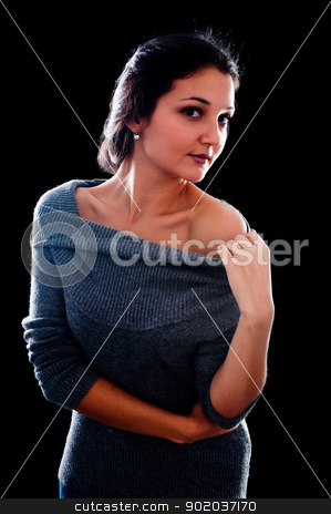 Pretty woman in sweater stock photo, Young beautiful woman in sweater. Isolated on black by Aikon