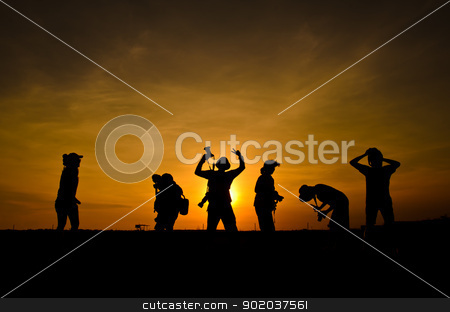 silhouette photographer. stock photo, silhouette of friends photographer in sunset. by chatchai