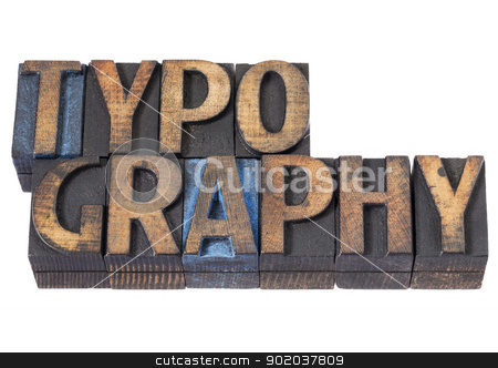 typography word in wood type stock photo, typography - isolated word in vintage letterpress wood type blocks stained by blue and black ink by Marek Uliasz