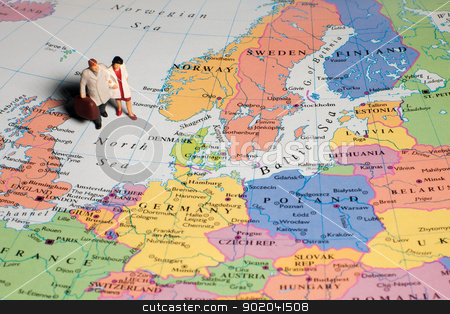 Europe Traveller stock photo, Miniature human figure as husband and wife traveller on a Europe map by Hasnuddin Abu Samah