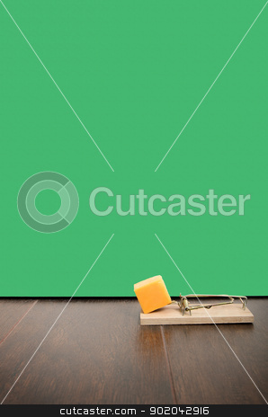 Mousetrap stock photo, Mousetrap set with cheddar cheese on a floor, next to a mouse hole. by Richard Nelson