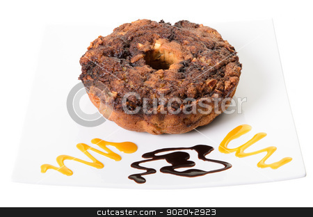 Apple Coffee Cake stock photo, Apple coffee cake on a platter with swirls of chocolate and caramel, isolated on a white background by Richard Nelson
