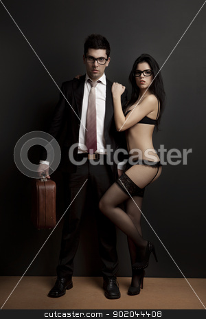 Work and Pleasure stock photo, Business man embraced with a sexy young woman in lingerie. Concept about work and pleasure by ikostudio