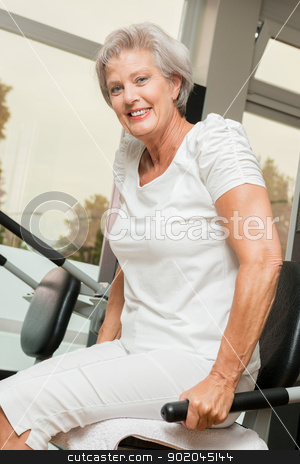 Active senior stock photo, Active and smiling senior in a gym by Picturehunter