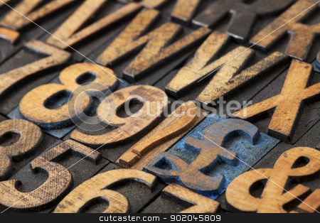 pound symbol in wood type stock photo, pound symbol among vintage letterpress  wood type blocks, selective focus by Marek Uliasz