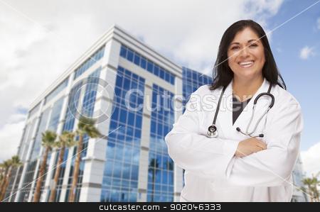 Attractive Hispanic Doctor or Nurse in Front of Building stock photo, Attractive Hispanic Doctor or Nurse in Front of Corporate Building. by Andy Dean