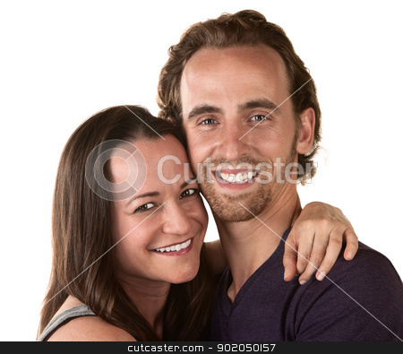Smiling Woman and Man Close Up stock photo, Smiling man and woman holding each other over white background by Scott Griessel
